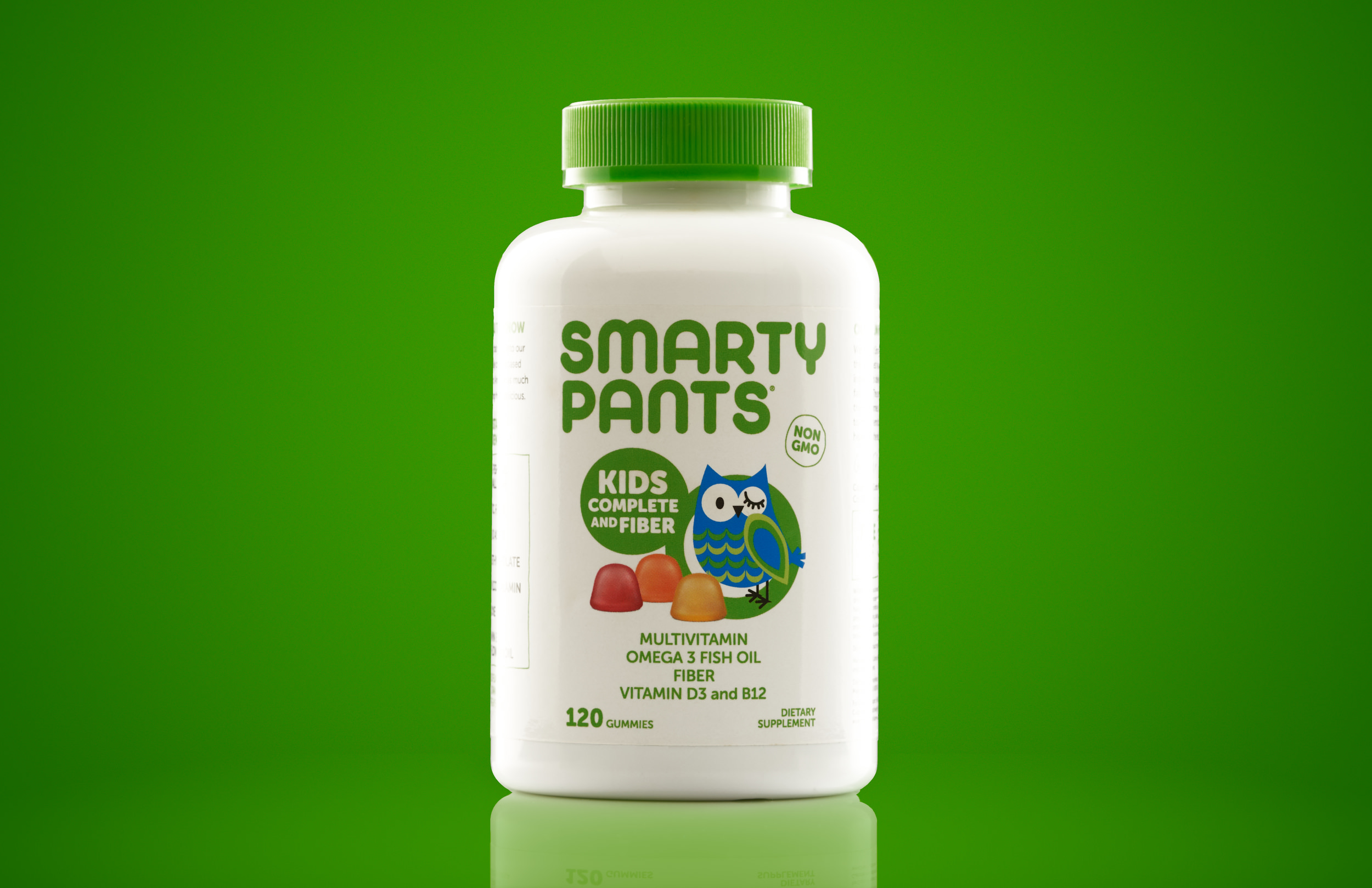 Studio picture of Smarty Pants vitamins with a green background