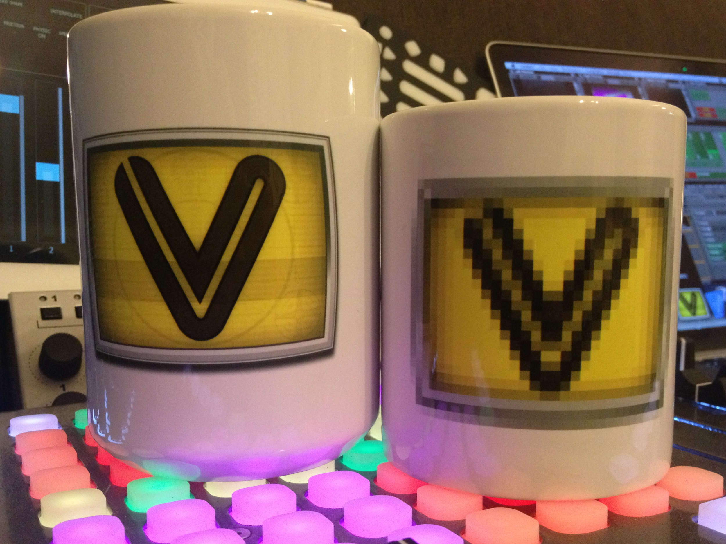 "Both ""VDMX5 Icon"" mugs look great with MIDI and OSC gear."
