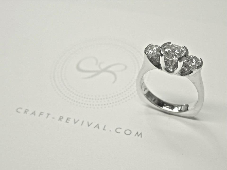 side-view-unique-semi-bezel-round-diamond-modern-three-stone-engagement-ring-diamond-round-shape-craft-revival-jewelry-store-grand-rapids