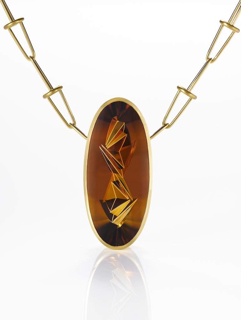 unique-yellow-gold-hessanite-garnet-munsteiner-pendant-craft-revival-jewelry-store-grand-rapids
