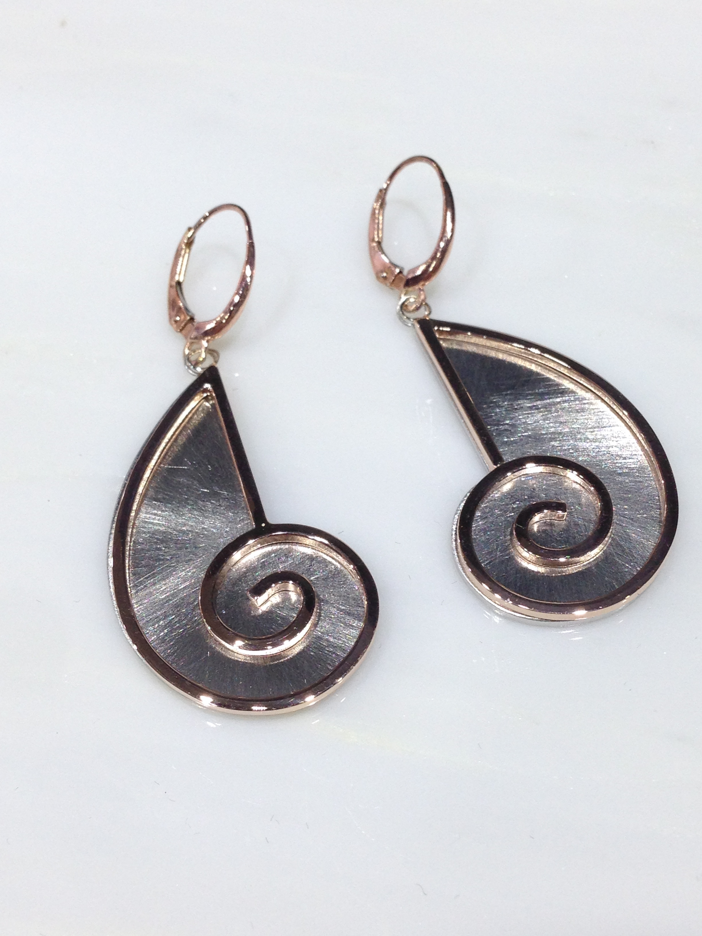 unique-spiral-two-toned-rose-gold-white-gold-drop-earrings-craft-revival-jewelry-store-grand-rapids
