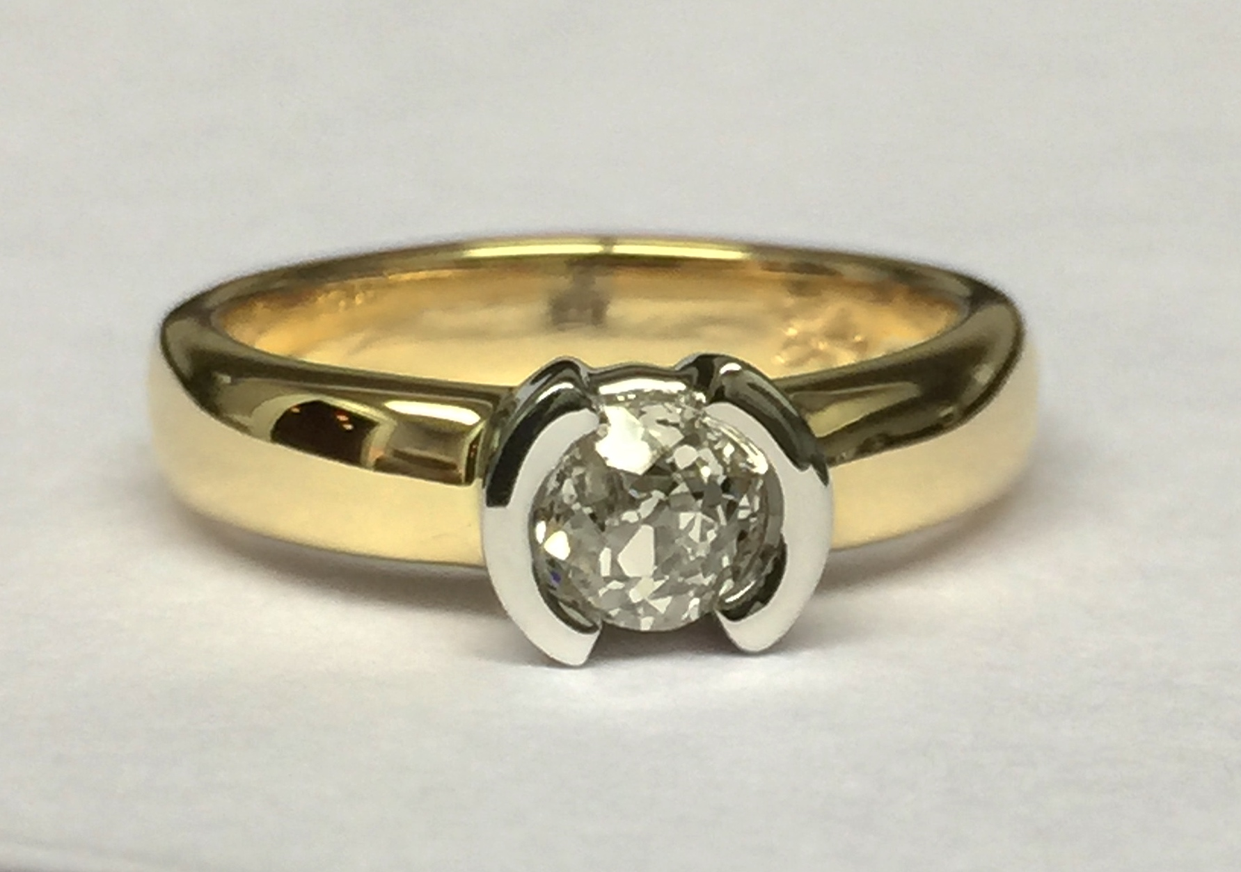 unique-modern-yellow-gold-diamond-minimal-engagement-ring-craft-revival-jewelry-store-grand-rapids