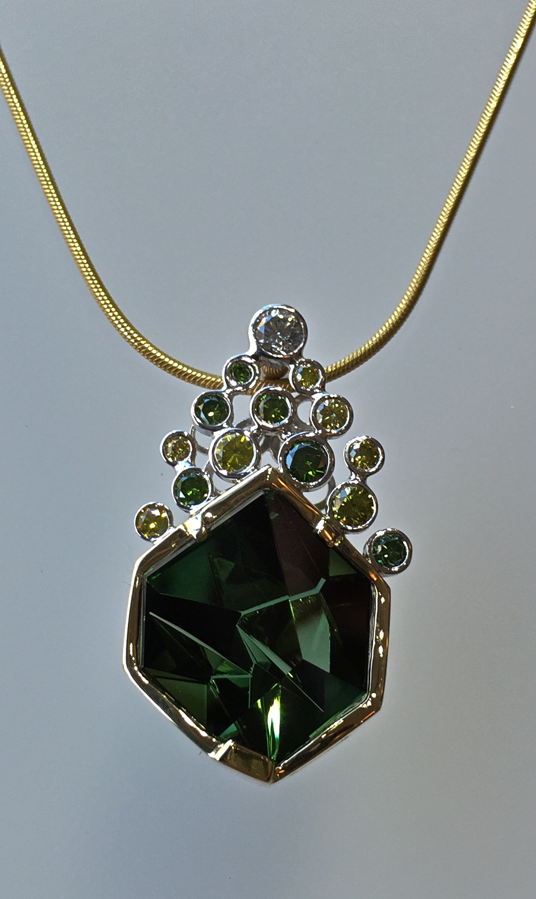 unique-green-tourmaline-munsteiner-stone-green-diamond-white-diamond-bezel-set-accents-yellow-gold-pendant-craft-revival-jewelry-store-grand-rapids