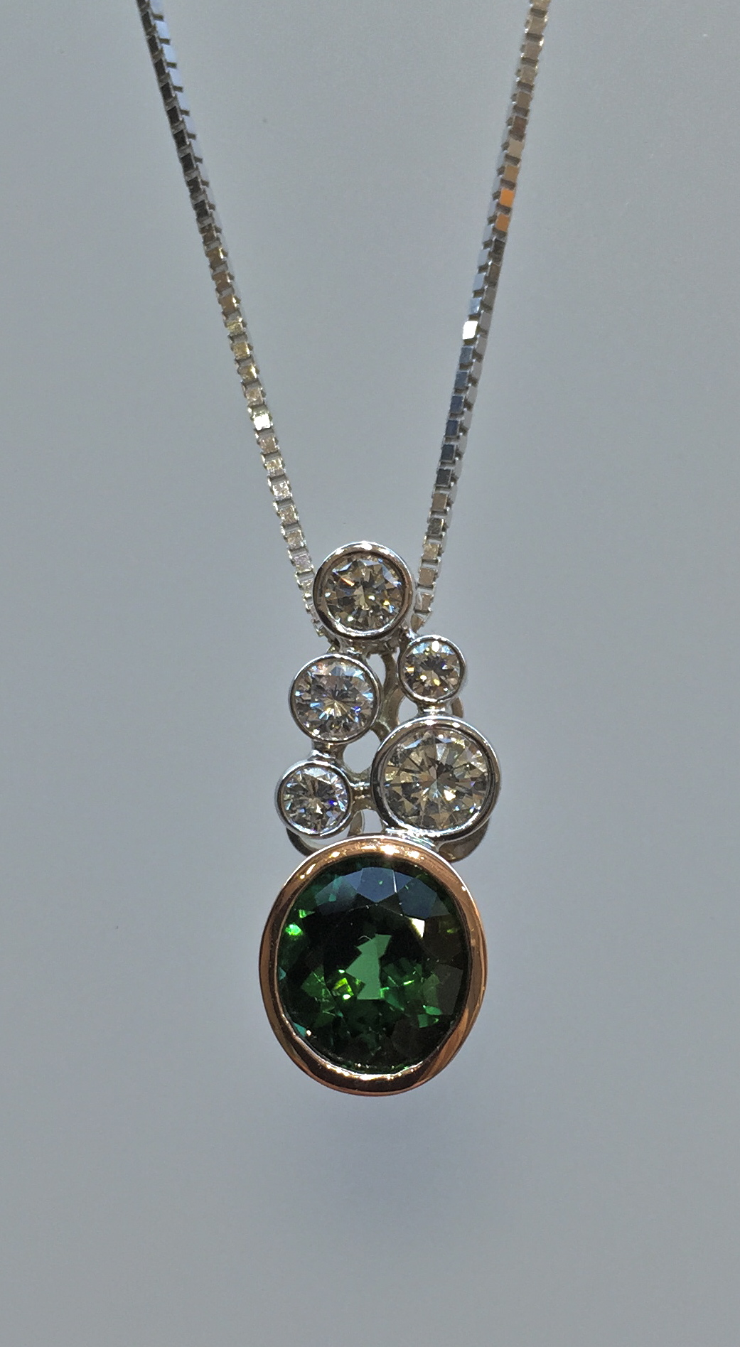 unique-green-tourmaline-stone-white-diamond-bezel-set-accents-yellow-gold-pendant-craft-revival-jewelry-store-grand-rapids