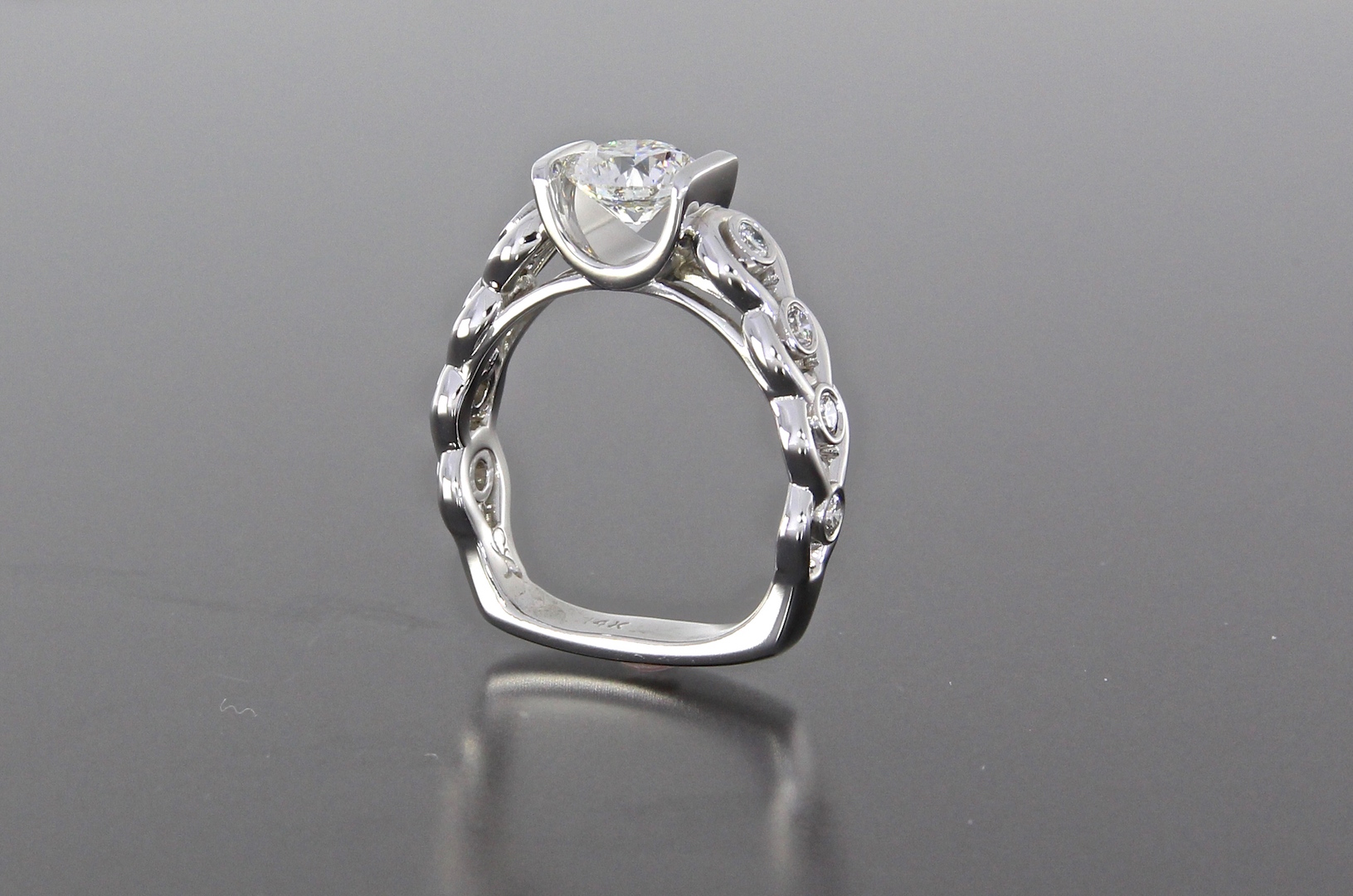 side-view-unique-custom-round-diamond-modern-engagement-ring-craft-revival-jewelry-store-grand-rapids