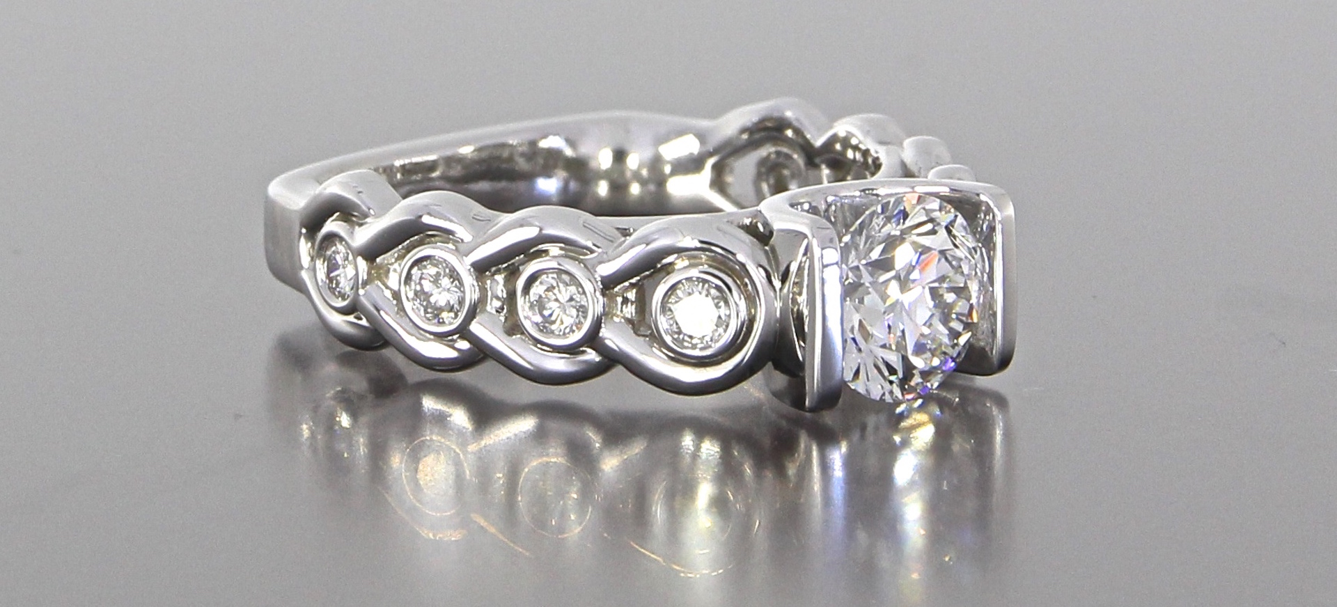 side-view-unique-round-diamond-modern-engagement-ring-craft-revival-jewelry-store-grand-rapids