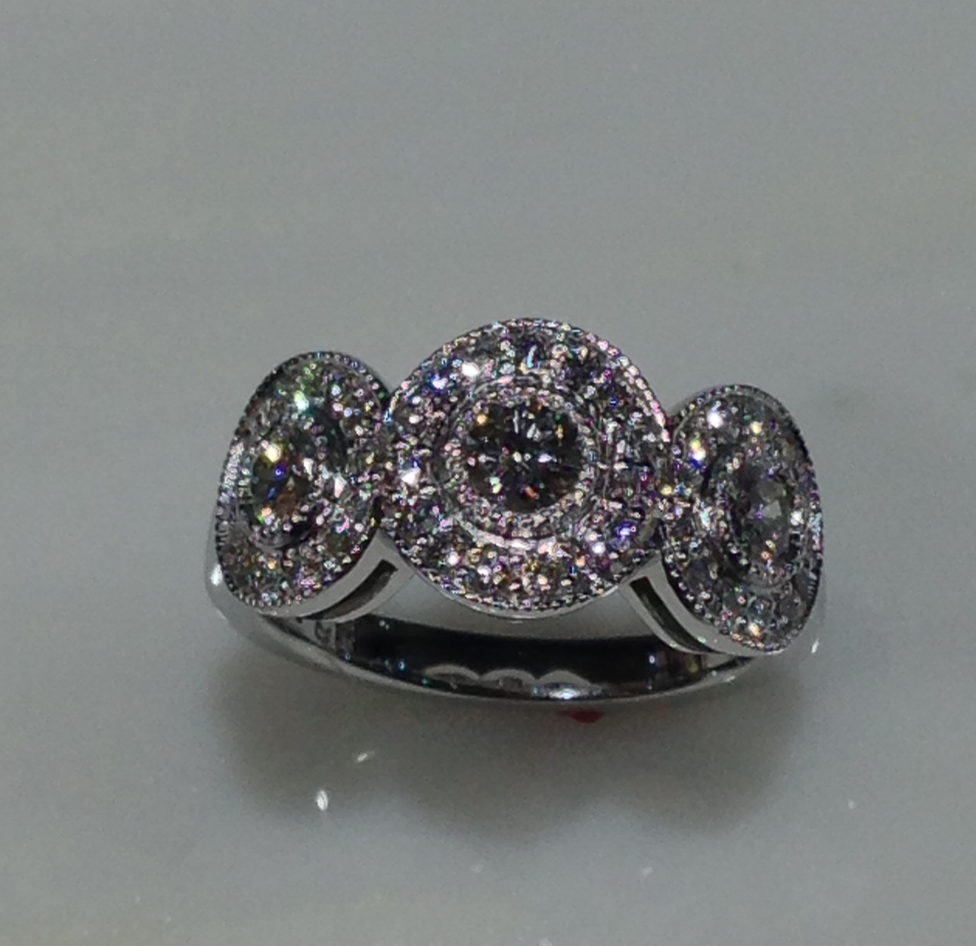 unique-antique-vintage-three-stone-diamond-halo-engagement-ring-top-view-craft-revival-jewelry-store-grand-rapids