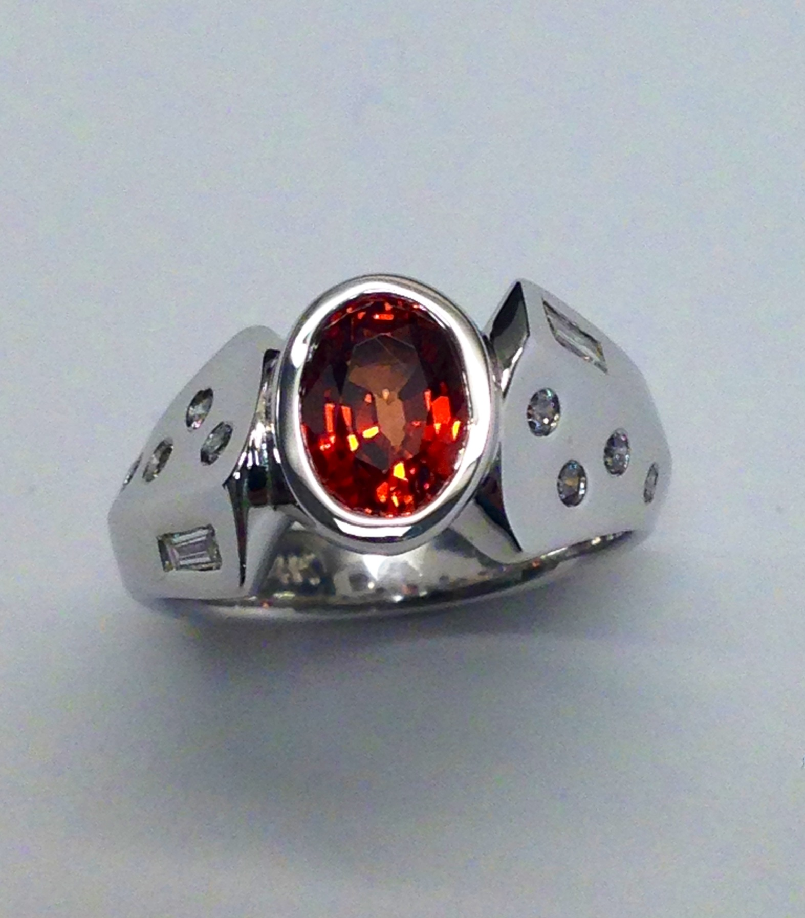 unique-oval-cut-orange-sapphire-alternative-bridal-engagement-ring-diamond-accents-white-gold-ring-craft-revival-jewelry-store-grand-rapids-michigan-west-michigan