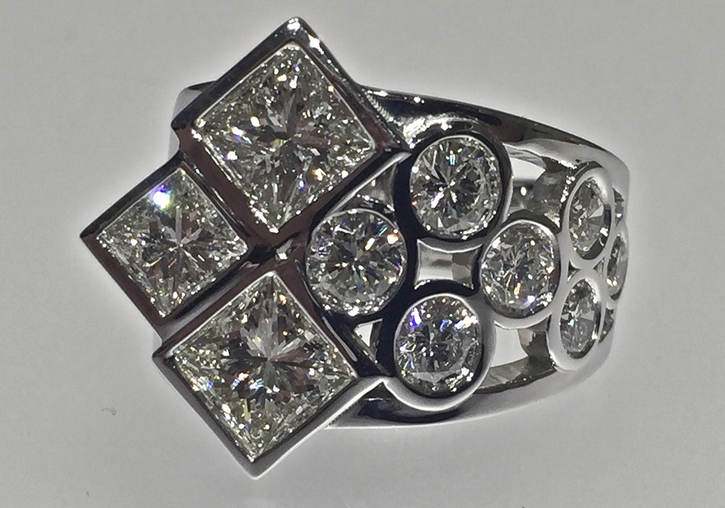 unique-custom-bezel-set-low-profile-princess-cut-diamond-round-cut-diamond-engagement-ring-craft-revival-jewelry-store-grand-rapids-michigan