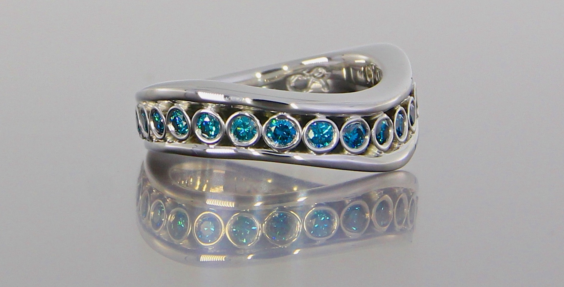 unique-custom-blue-diamond-white-gold-wedding-band-craft-revival-jewelry-store-grand-rapids