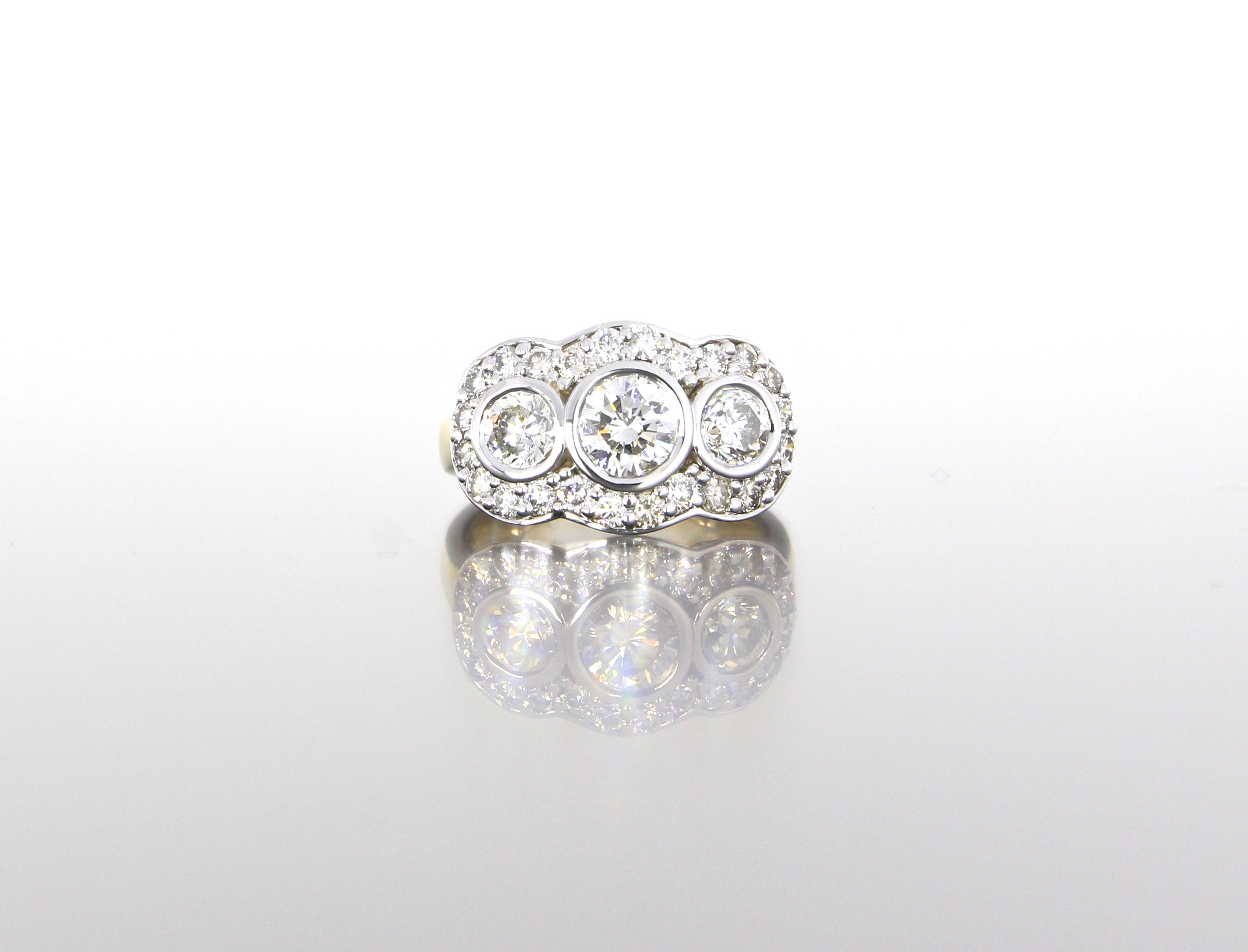 unique-three-stone-diamond-halo-white-gold-yellow-gold-craft-revival-jewelry-store-grand-rapids
