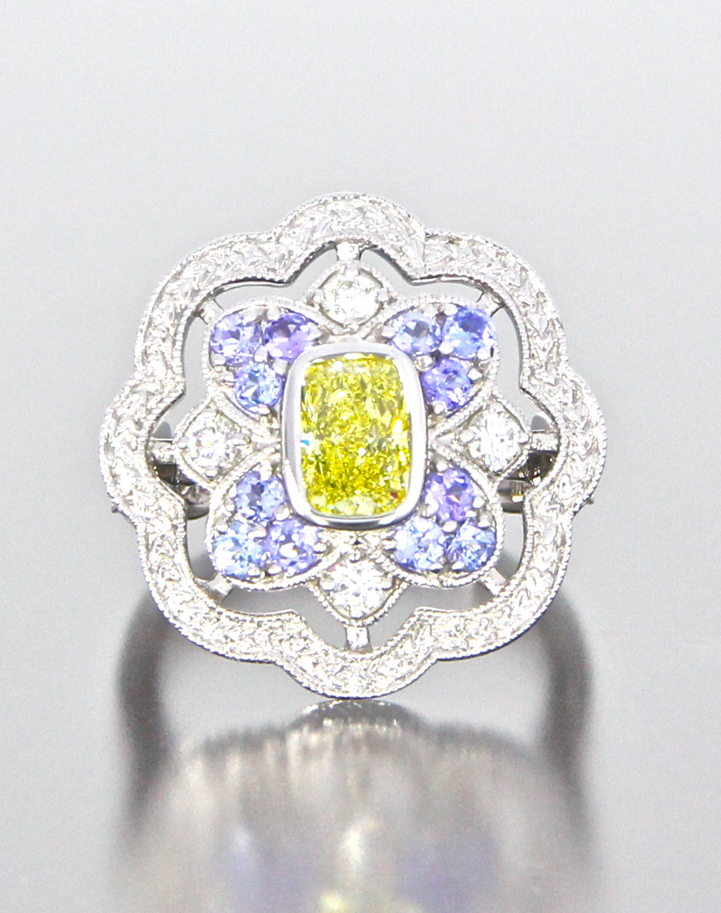 unique-antique-cushion-cut-yellow-diamond-halo-engagement-ring-craft-revival-jewelry-store-grand-rapids