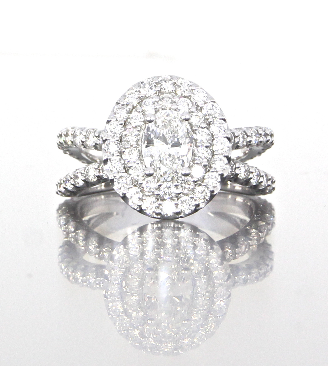 unique-delicate-oval-shape-diamond-double-halo-engagement-ring-craft-revival-jewelry-store-grand-rapids