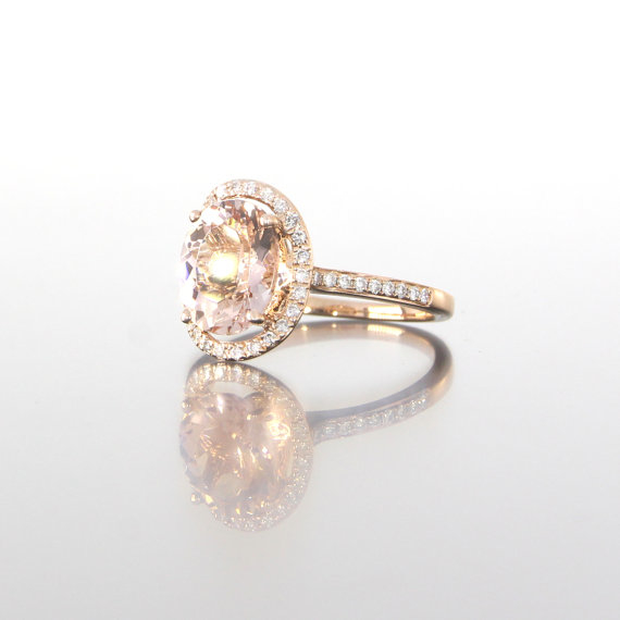 side-view-unique-oval-morganite-delicate-diamond-halo-rose-gold-engagement-ring-craft-revival-jewelry-grand-rapids