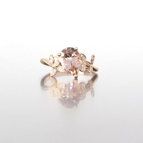 unique-rose-gold-pear-shape-morganite-diamonds-alternative-engagement-ring-craft-revival-jewelry-store-grand-rapids