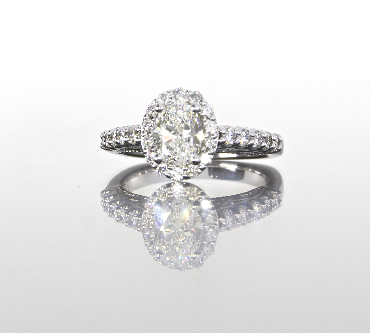 unique-oval-shape-delicate-halo-engagement-ring-craft-revival-jewelry-store-grand-rapids