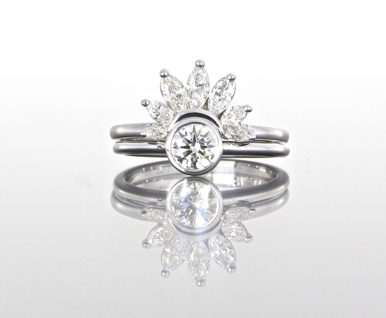 unique-round-diamond-delicate-marquise-diamond-halo-engagement-rings-craft-revival-jewelry-store-grand-rapids