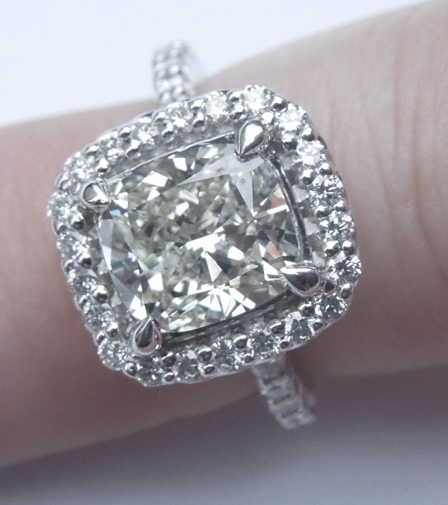 unique-cushion-cut-diamond-halo-delicate-engagement-ring-grand-rapids-jewelry-store-craft-revival