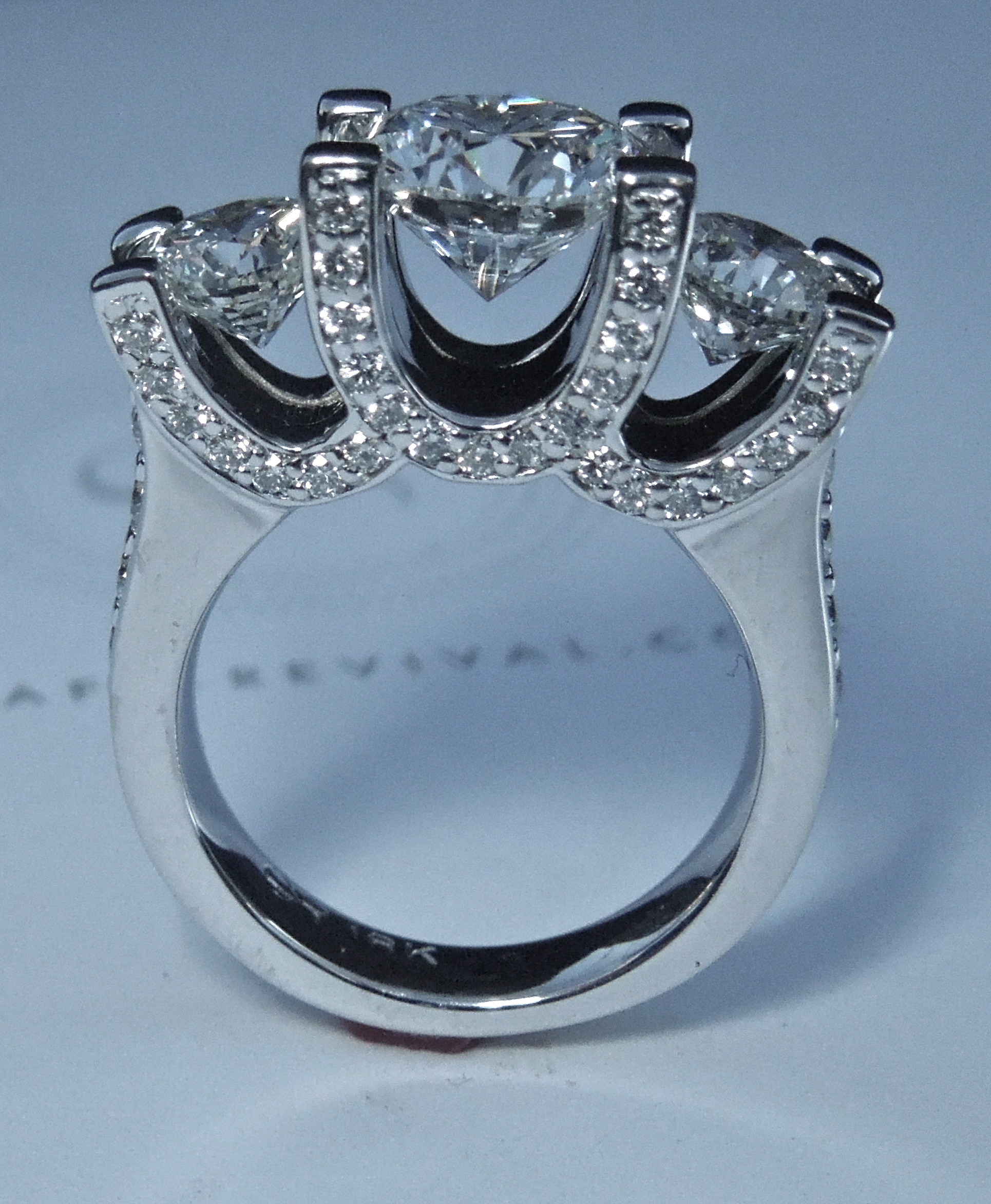 side-view-unique-diamond-engagement-ring-three-stone-ring-craft-revival-jewelry-store-grand-rapids