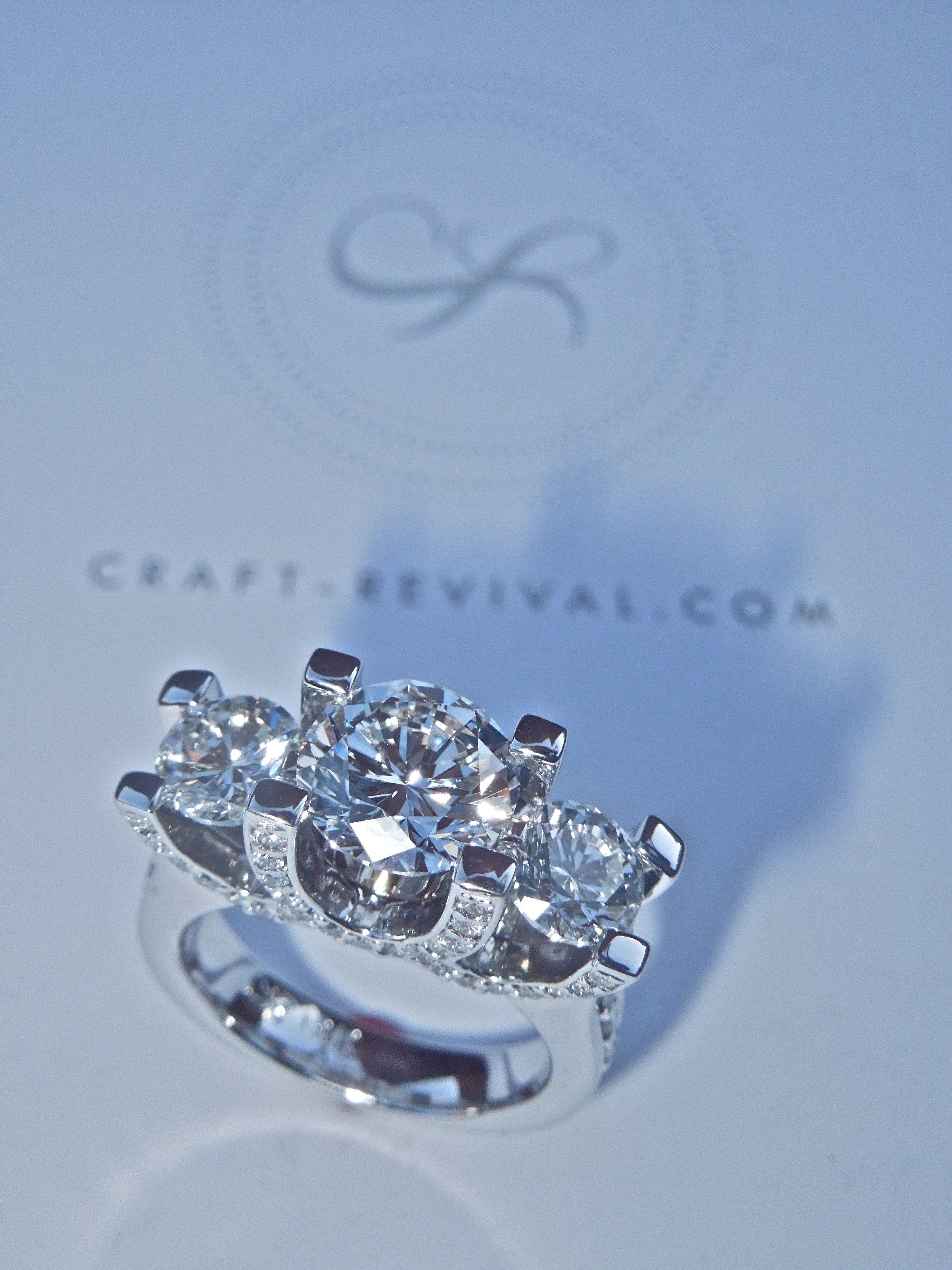unique-diamond-engagement-ring-three-stone-ring-craft-revival-jewelry-store-grand-rapids