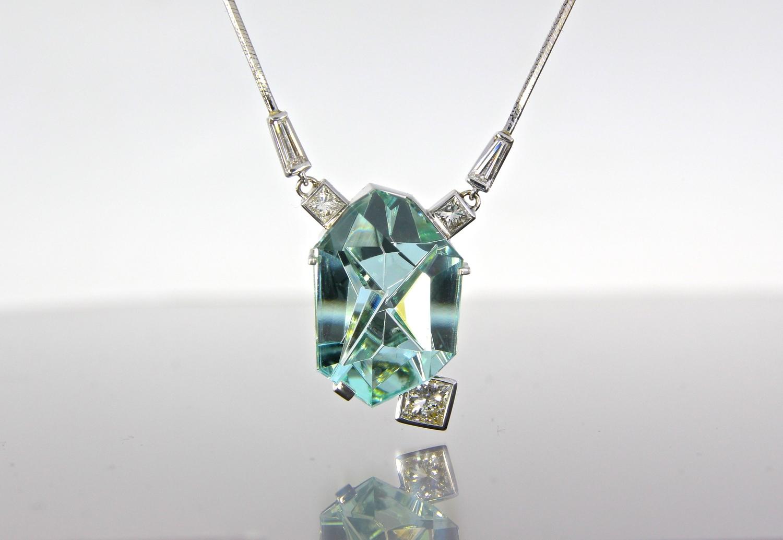unique-custom-blue-tourmaline-munsteiner-stone-diamond-accents-white-gold-necklace-craft-revival-jewelry-store-grand-rapids