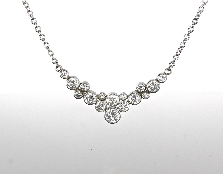 unique-diamond-bezel-set-cluster-necklace-white-gold-craft-revival-jewelry-store-grand-rapids