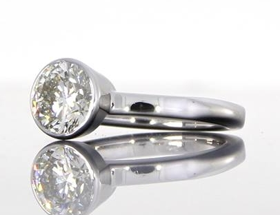 unique-round-diamond-delicate-engagement-ring-craft-revival-jewelry-store-grand-rapids