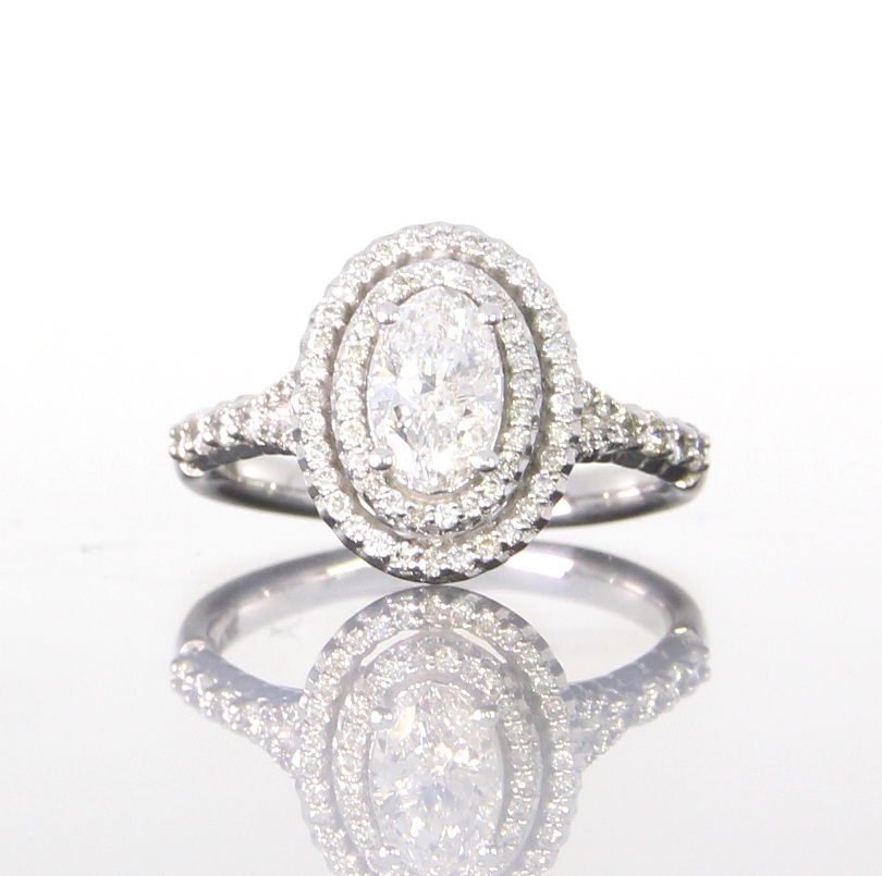 unique-oval-diamond-halo-engagement-ring-craft-revival-jewelry-store-grand-rapids.jpg