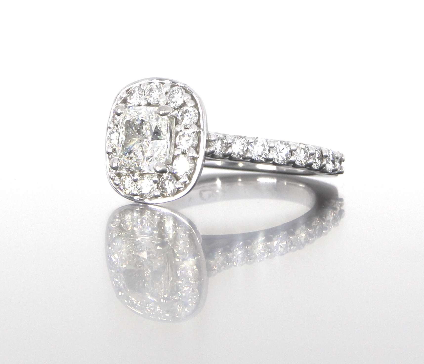 side-view-unique-cushion-cut-diamond-halo-engagement-ring-craft-revival-jewelry-store-grand-rapids.jpg