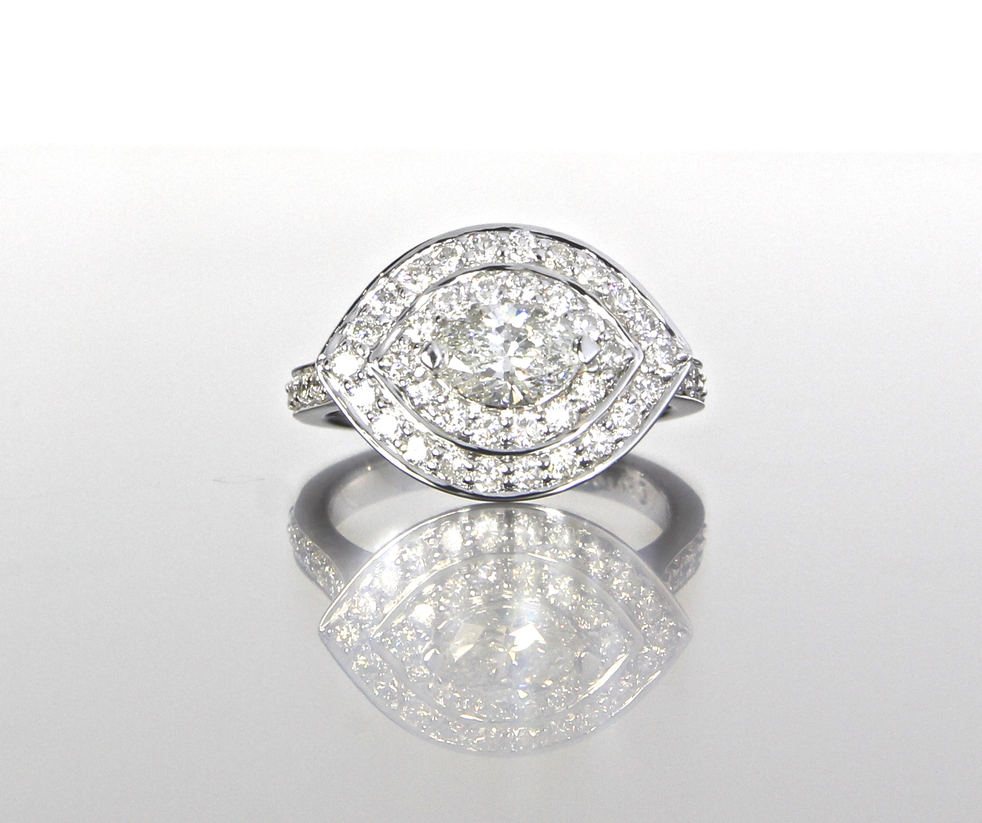 unique-marquise-diamond-engagement-ring-double-halo-craft-revival-jewelry-store-grand-rapids.jpg