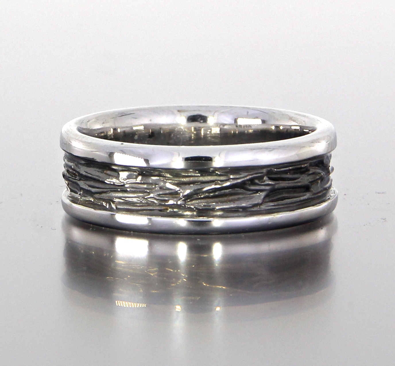 unique-mens-textured-wedding-band-black-band-gun-metal-white-gold-modern-design-craft-revival-jewelry-store-grand-rapids