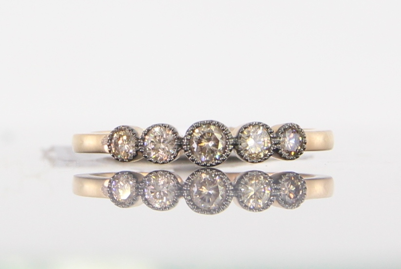 unique-ladies-yellow-gold-band-delicate-dainty-simple-round-diamond-vintage-ladies-wedding-band-craft-revival-jewelry-store-grand-rapids