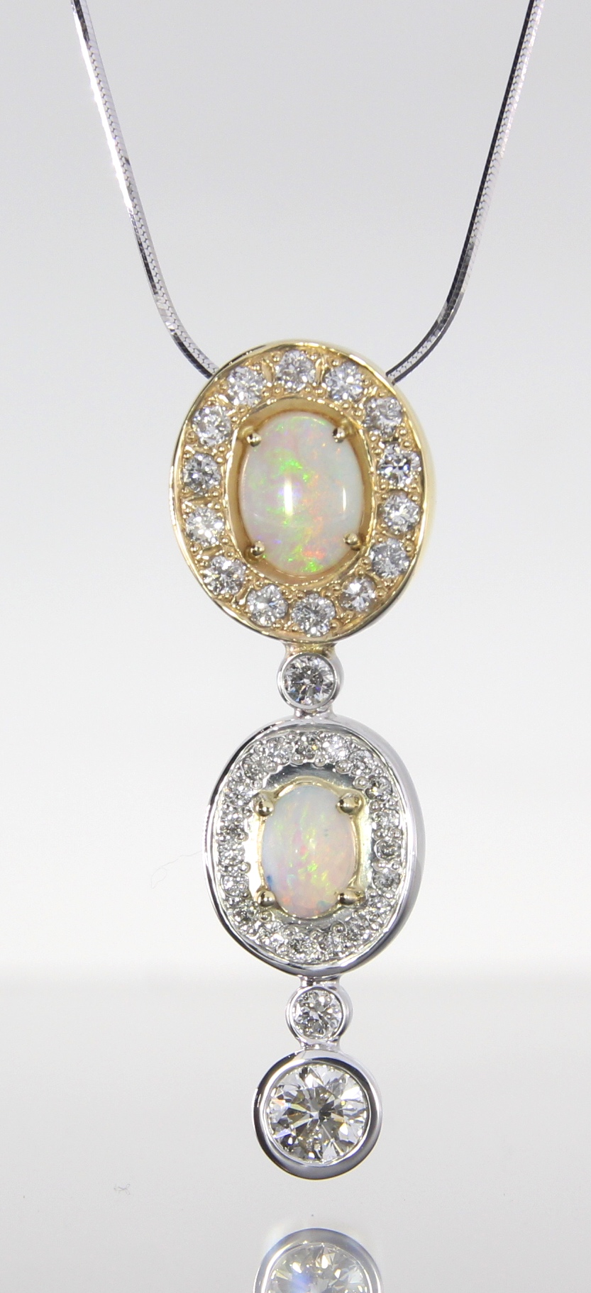 unique-custom-opal-pendant-diamond-halo-diamond-accents-craft-revival-jewelry-store-grand-rapids