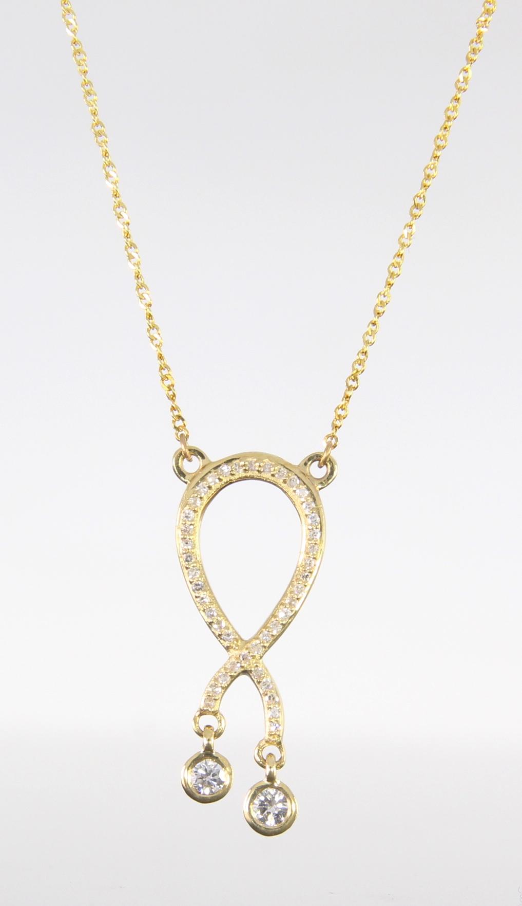unique-diamond-fashion-pendant-ribbon-pendant-yellow-gold-delicate-necklace-grand-rapids-jewelry-store