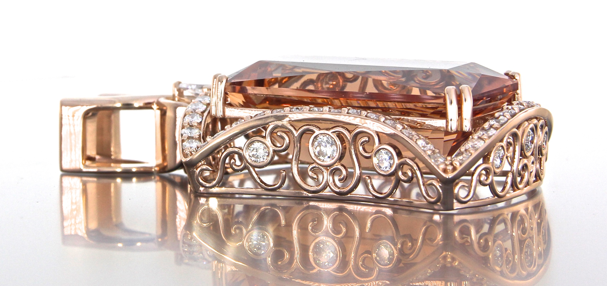 unique-custom-morganite-pendant-rose-gold-diamonds-halo-pendant-side-view-craft-revival-jewelry-store-grand-rapids