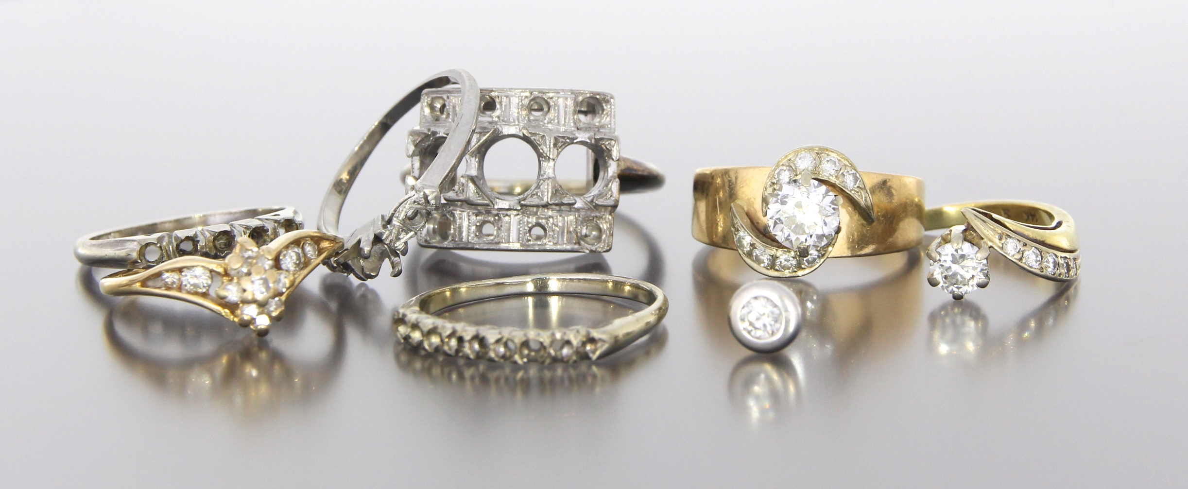 A collection on sentimental pieces, old rings that were out of style, and left over gold with a wish to create something new and beautiful from her pieces....