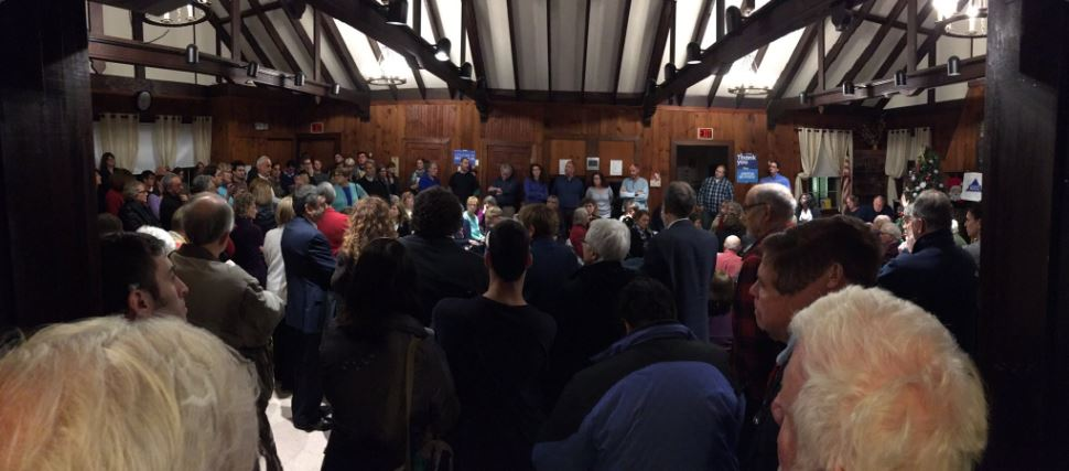 A photo of the overflow crowd at the December 1 meeting where activists called upon Newton officials to defend immigrants in our city.
