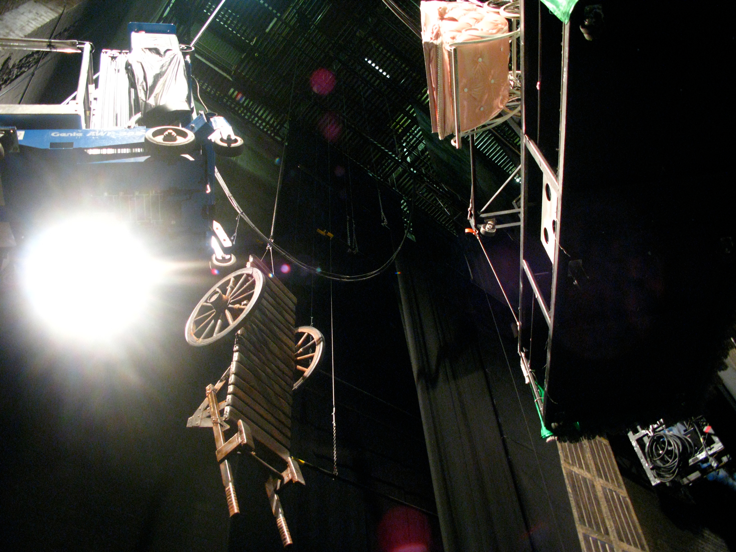 "Large props and scenic pieces hanging in the air (from ""Spamalot"")"