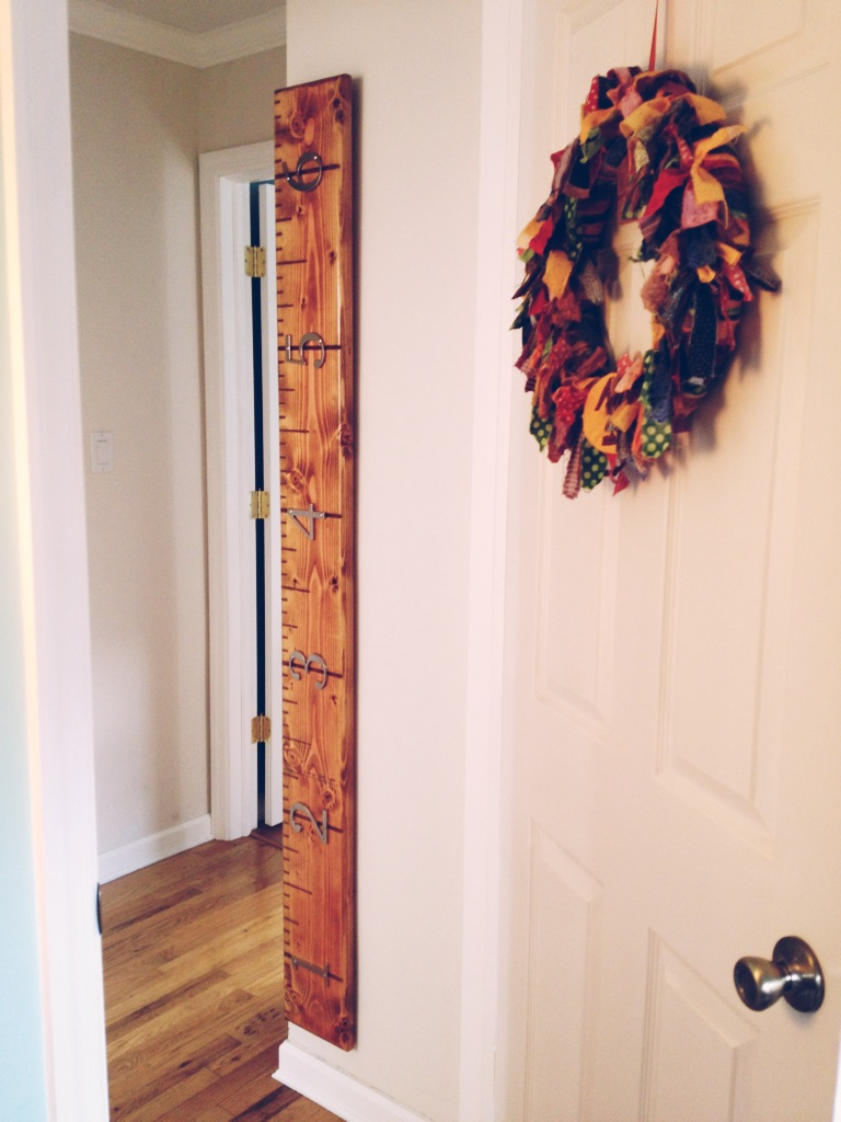 The growth chart that Eric made hangs outside Lila's room.