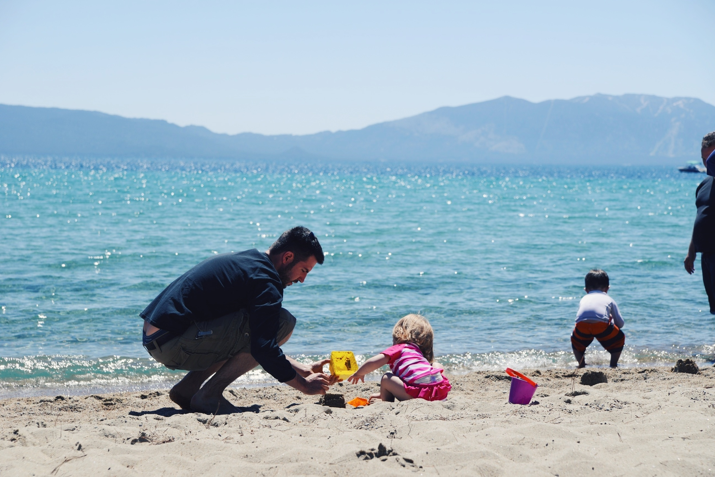 Lila and Eric building sand castles