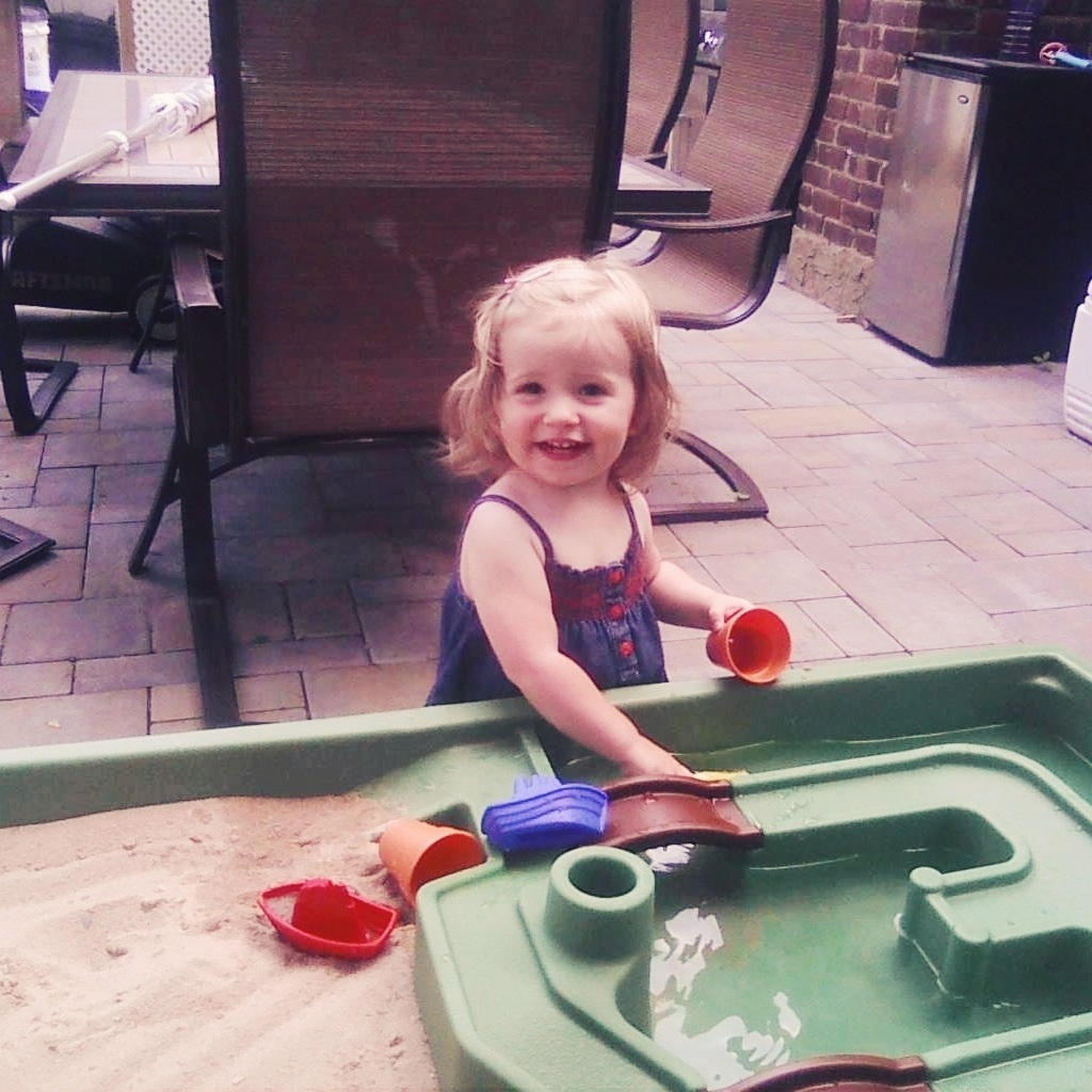 Lila loves her new sand and water table!
