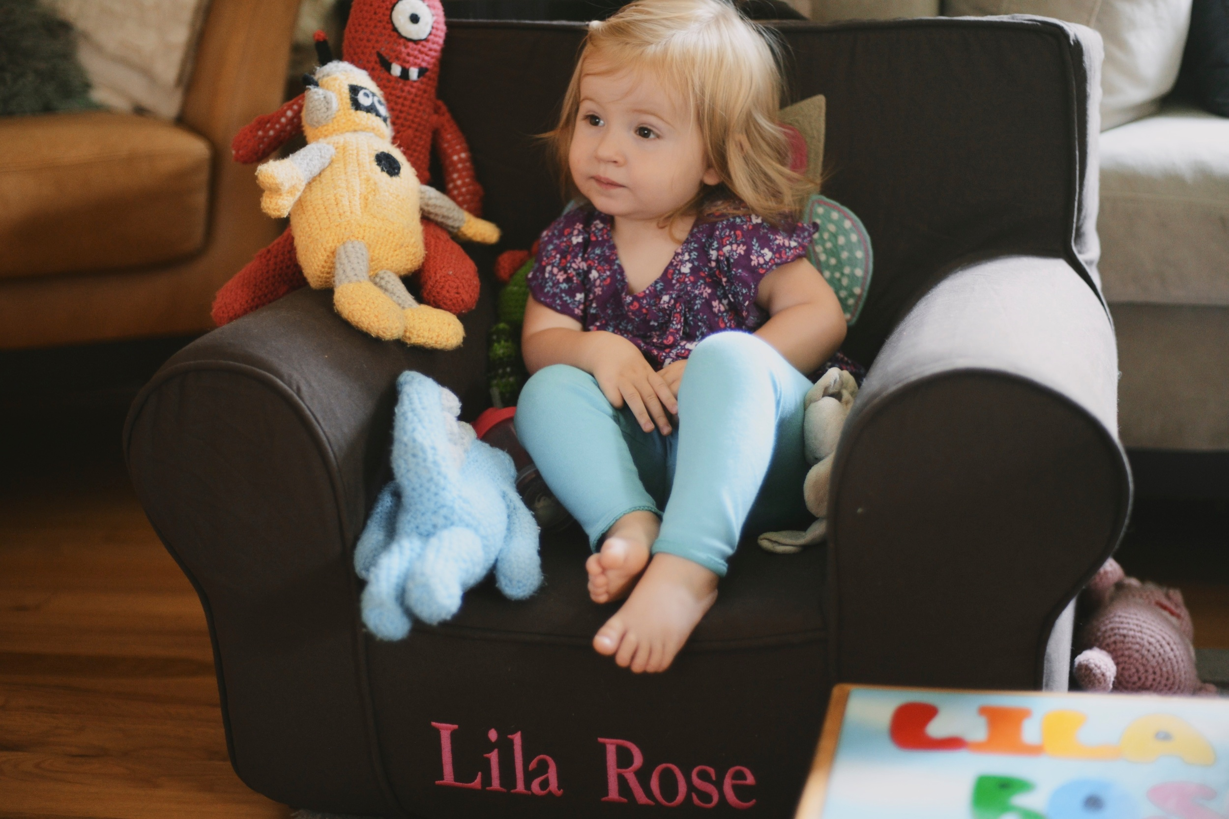 """Watching her """"Baby Babble"""" DVD in her new chair"""
