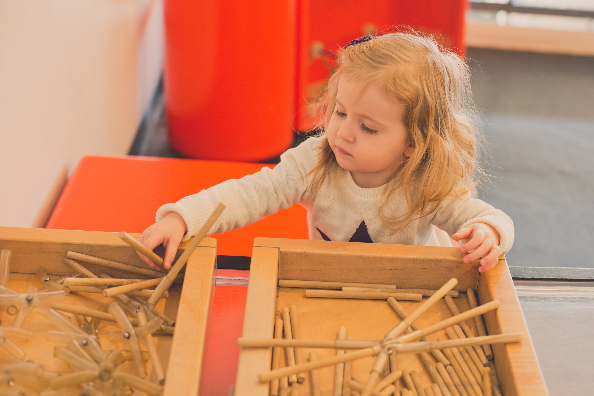 Playing with sticks at the Children's Museum.