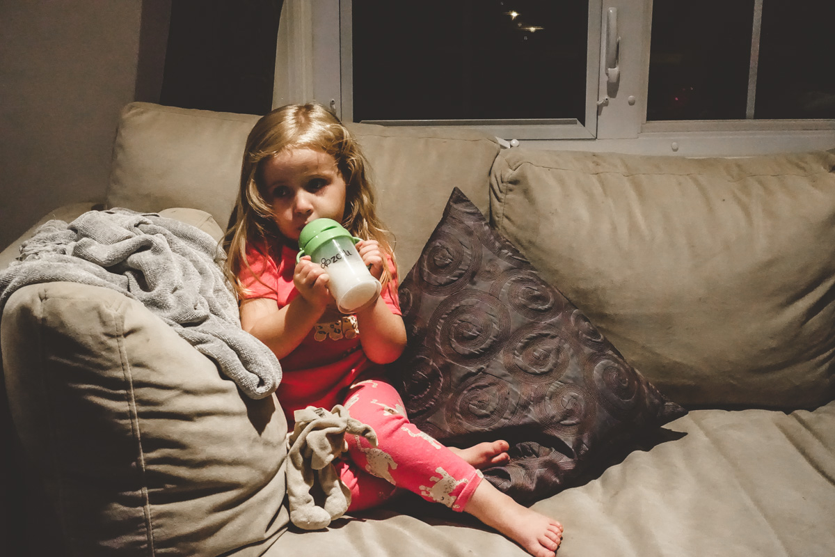 8:40pm:One kid in bed, the other having her milk.