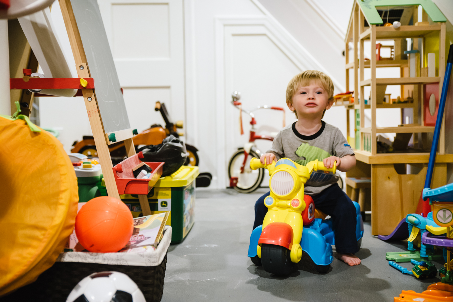 boy-on-motorcycle-toy-francesca-russell-photography-and-films-long-island-family-photographer.jpg