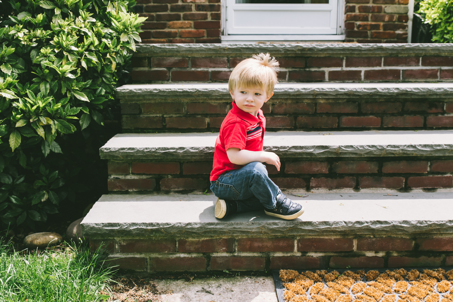 little-boy-on-porch-francesca-russell-photography-and-films-long-island-family-photographer.jpg