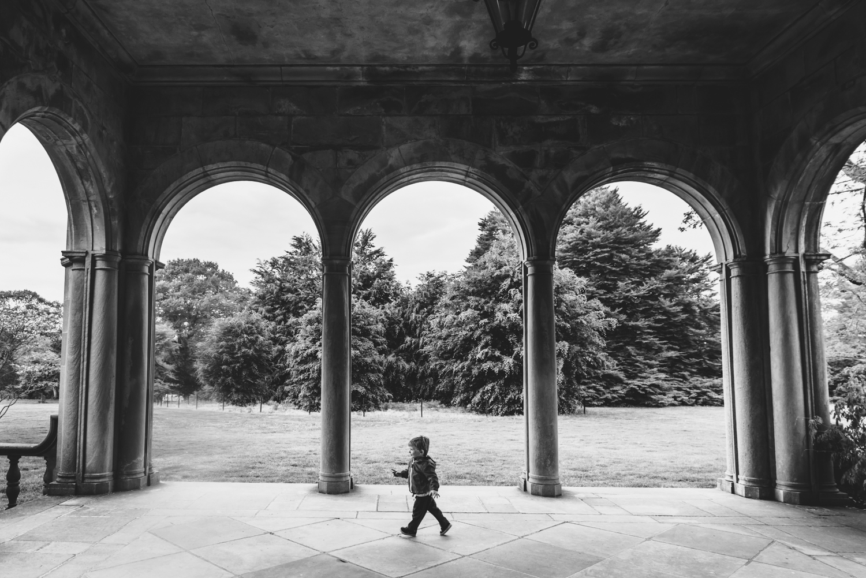 boy-runs-under-arch-francesca-russell-photography-and-films-long-island-family-photographer.jpg