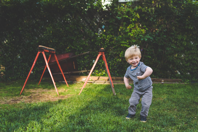 Boy dancing in backyard | Francesca Russell Photography & Films | Garden City Family Photographer