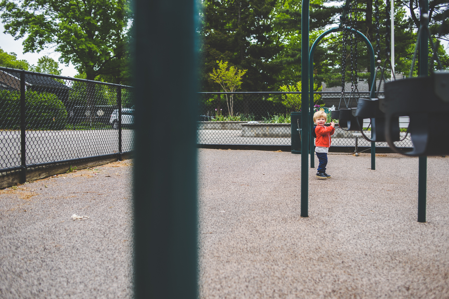 Little boy at swings | Francesca Russell Photography & Films | Garden City Family Photographer
