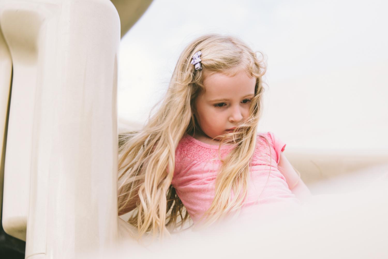 Girl on slide | Francesca Russell Photography & Films | Garden City Family Photographer